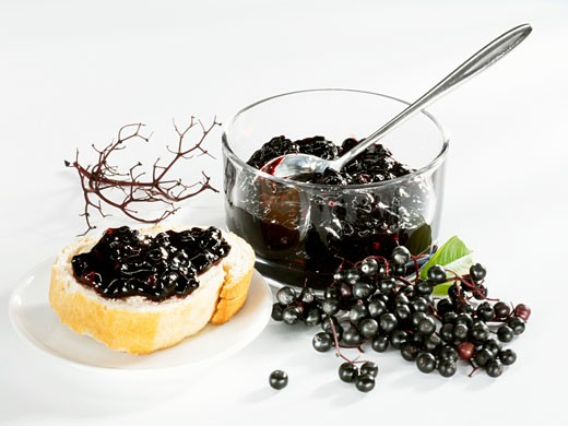 Stock Photo: 1532R-23323 Elderberry jam on bread and in a small glass bowl