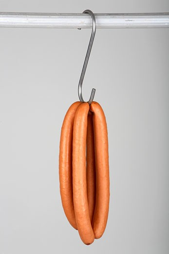 Two pairs of frankfurters on a hook : Stock Photo