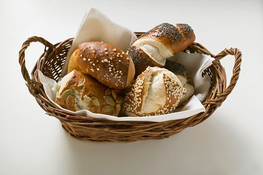 Assorted pretzel rolls in bread basket : Stock Photo