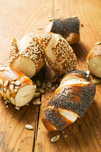 Assorted pretzel rolls on wooden background : Stock Photo