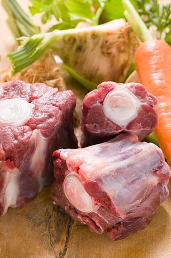 Oxtail and fresh soup vegetables : Stock Photo