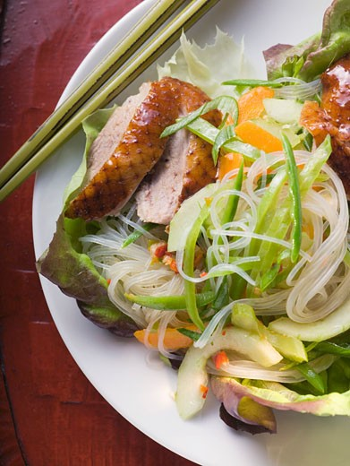 Lettuce with roast duck breast, vegetables, glass noodles (Asia) : Stock Photo