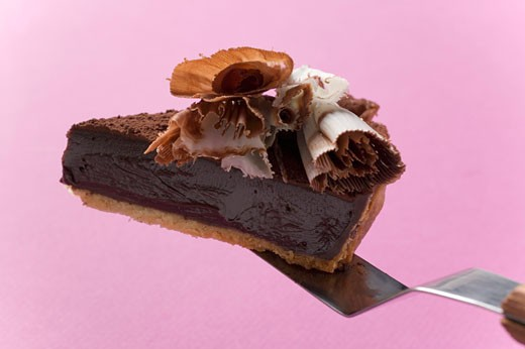 Piece of chocolate tart on cake server : Stock Photo