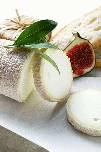 Stock Photo: 1532R-26847 Cheese still life with bread and half a fig