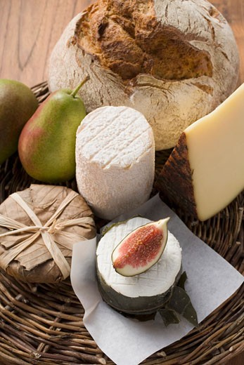 Cheese still life with bread, pears and fig : Stock Photo