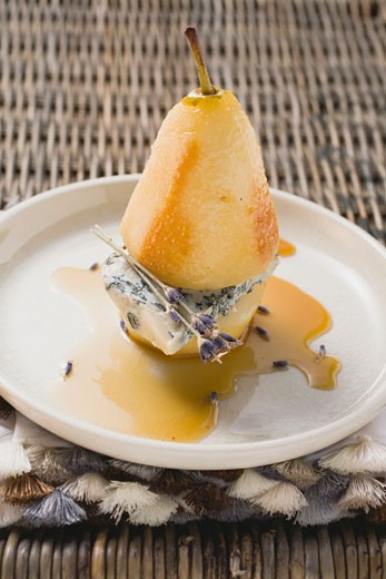 Poached pear with blue cheese and lavender flowers : Stock Photo