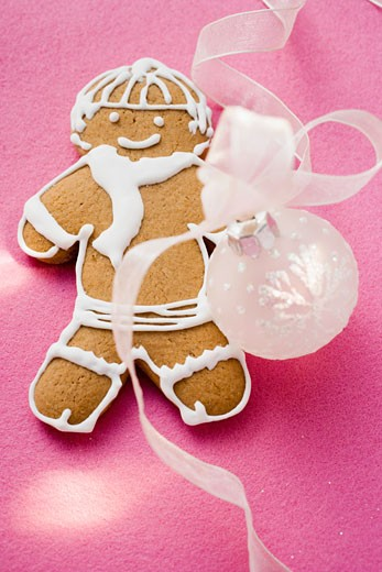 Gingerbread man and Christmas bauble : Stock Photo