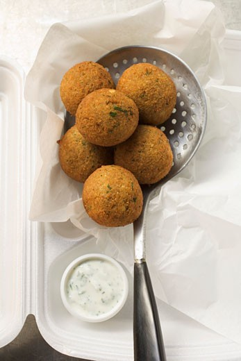 Falafel (chick-pea balls) with yoghurt dip in lunch box : Stock Photo
