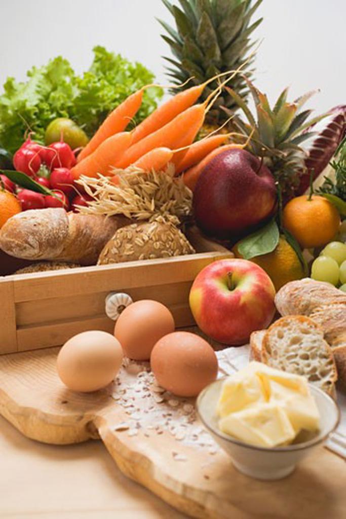 Still life: vegetables, fruit, eggs, butter & wholemeal bread : Stock Photo