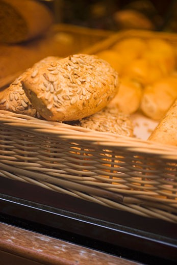 Stock Photo: 1532R-28615 Assorted bread rolls in a basket at a market