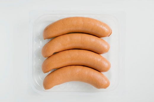 Frankfurters in plastic tray : Stock Photo