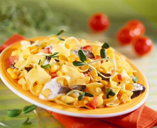 Ribbon pasta with sweetcorn and sprouts : Stock Photo