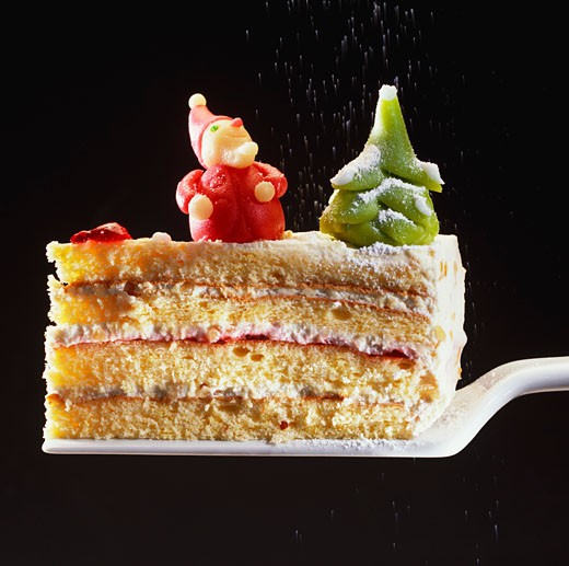 A piece of cream cake with Christmas decorations : Stock Photo