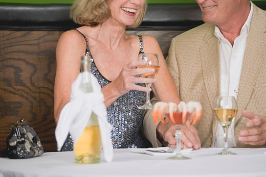 Mature couple with wine and shrimps in restaurant : Stock Photo