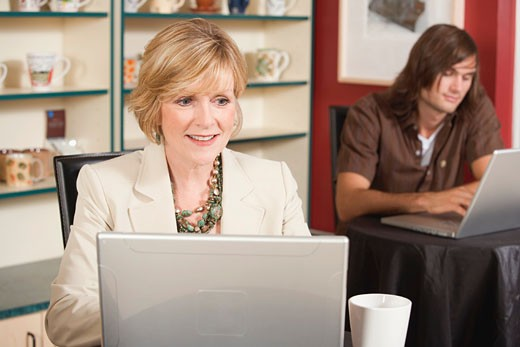 Stock Photo: 1532R-30366 Mature woman at laptop in a café
