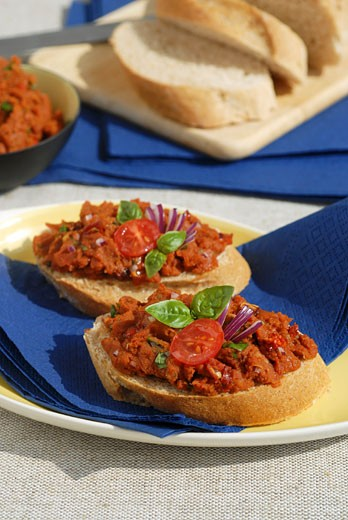Stock Photo: 1532R-30693 Tomato spread on baguette slices