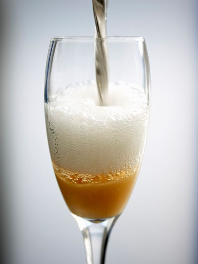 Pouring a Bellini : Stock Photo