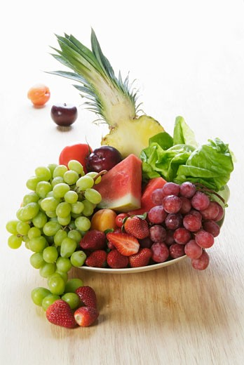 Stock Photo: 1532R-31167 Plate of fruit: grapes, melon, pineapple, strawberries etc.
