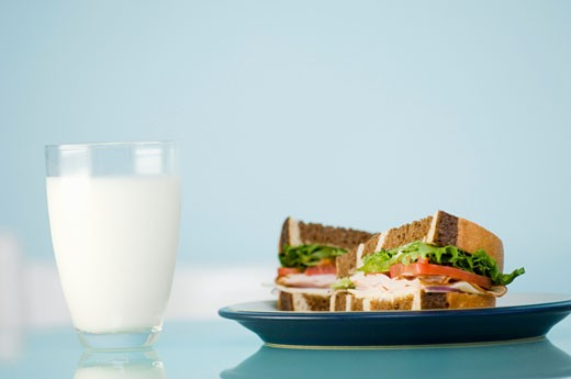 Stock Photo: 1532R-31344 A glass of milk and a sandwich in marble bread