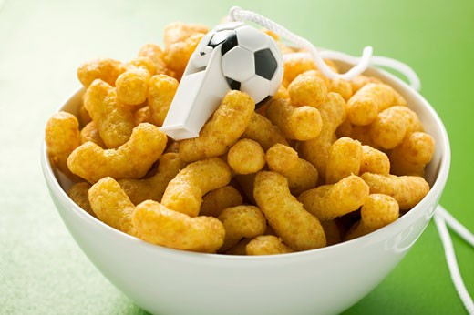 Stock Photo: 1532R-31374 Peanut puffs with whistle in a bowl