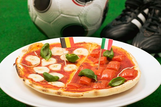 Pizza with the flags of Belgium and Italy : Stock Photo