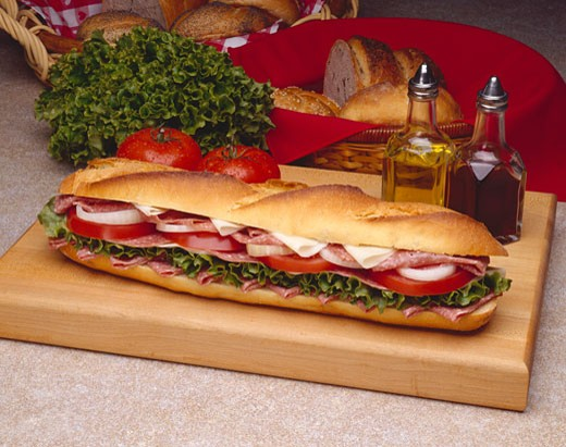 Stock Photo: 1532R-31597 Salami and Provolone Submarine Sandwich on a Cutting Board
