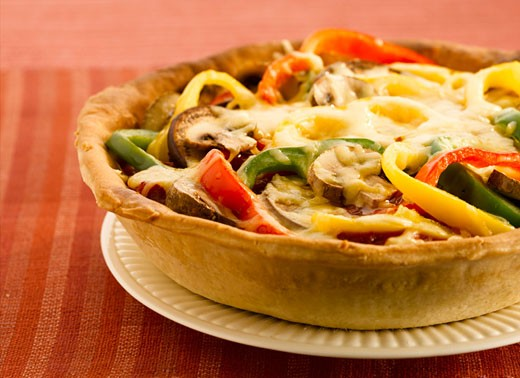 Pepper and mushroom tart with melted cheese topping : Stock Photo