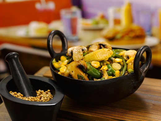 Stir-fried mushrooms, sweetcorn and beans in a small pan : Stock Photo