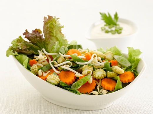 Mixed salad with carrots, lettuce and baby corn cobs : Stock Photo