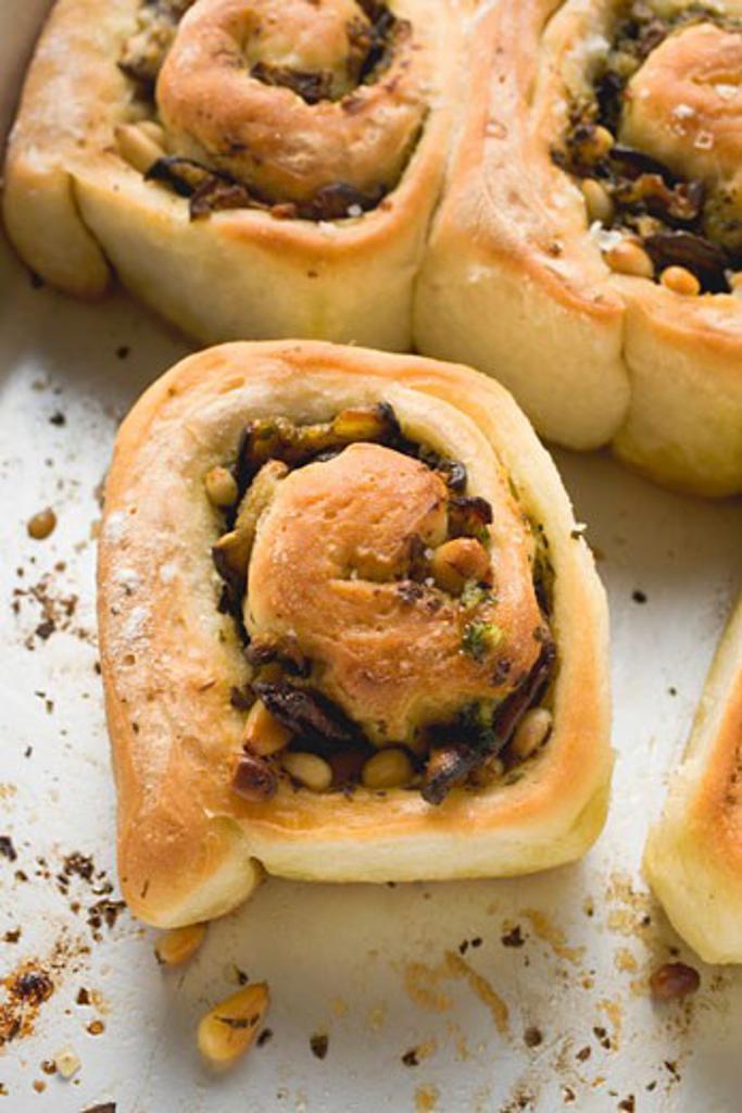 Savoury pinwheels with pesto and pine nuts : Stock Photo