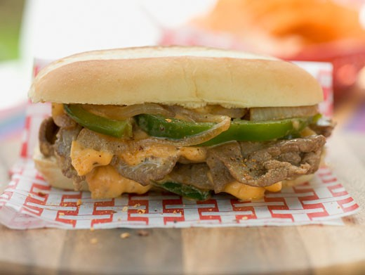 Döner sandwich with green peppers, onions and cheese : Stock Photo