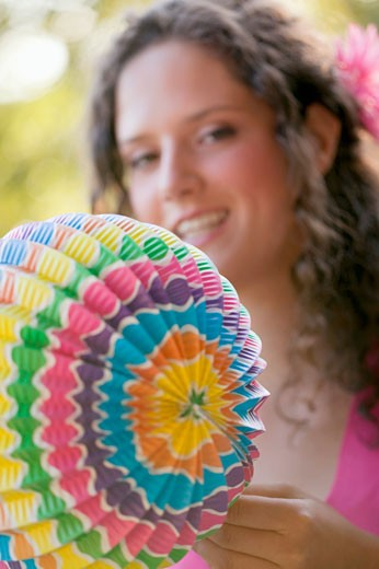 Woman holding coloured Chinese lantern : Stock Photo