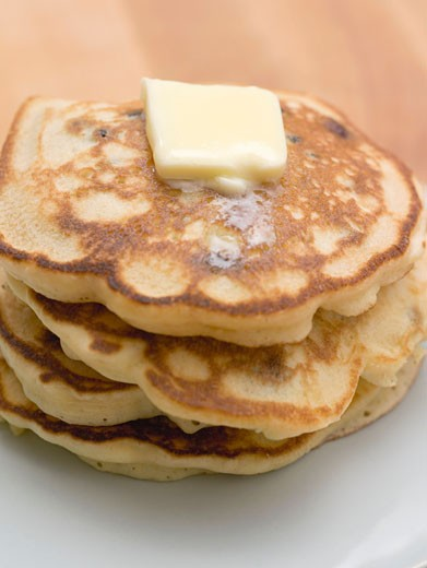 Pancakes with a knob of butter : Stock Photo