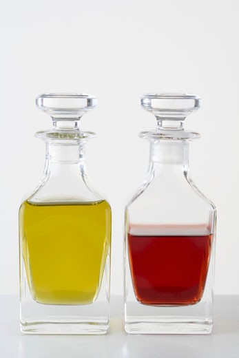 Olive oil and vinegar in small glass bottles : Stock Photo