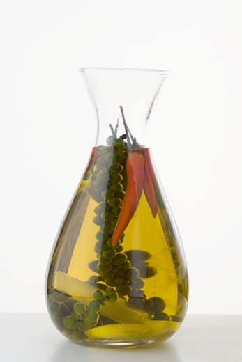 Stock Photo: 1532R-35055 Chilli oil with green peppercorns in a carafe