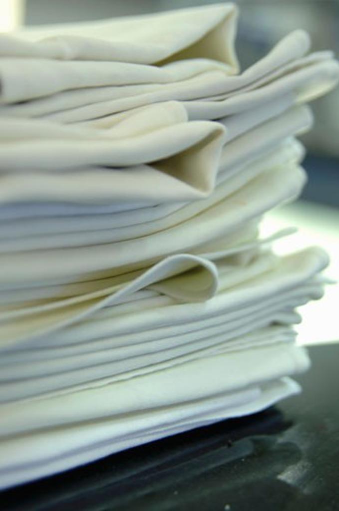 Stock Photo: 1532R-35288 A pile of folded fabric napkins