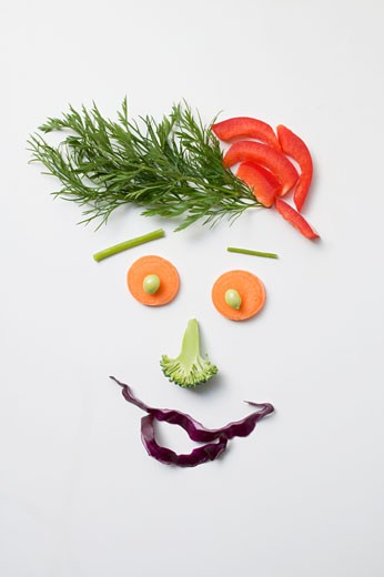 Amusing face made from vegetables and dill : Stock Photo