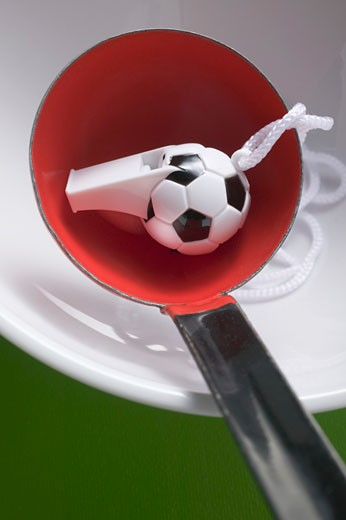 Football whistle in ladle : Stock Photo
