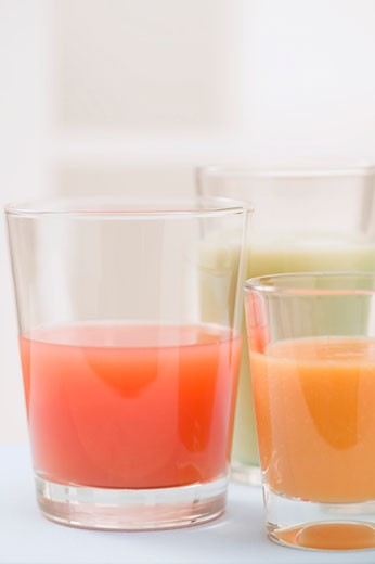 Three different juices in glasses : Stock Photo