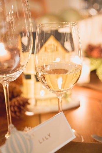 Stock Photo: 1532R-36534 Wine glasses, place card and candles on Christmas table