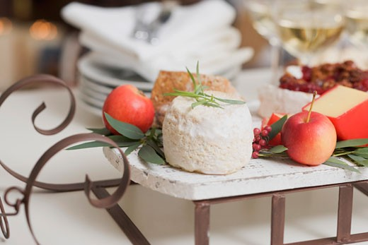 Stock Photo: 1532R-36550 Cheese and apples on small sleigh for Christmas