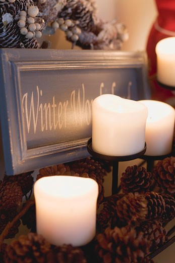 Stock Photo: 1532R-36577 Candles, pine cones and festive sign