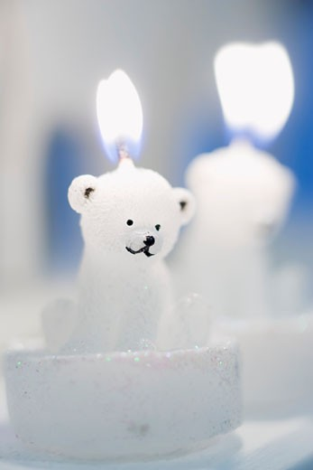 Polar bear candle, lit : Stock Photo