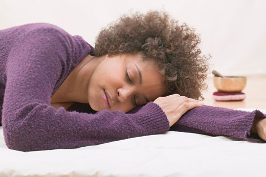 Young woman asleep during a relaxation exercise : Stock Photo