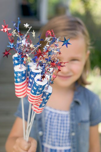 Stock Photo: 1532R-38498 Small girl holding 4th of July decorations (USA)
