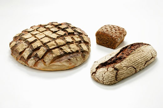 Three different loaves of wood-oven bread : Stock Photo