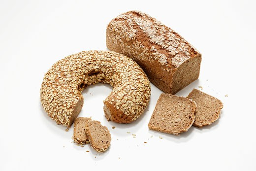 Two loaves of wholemeal bread, partly sliced : Stock Photo