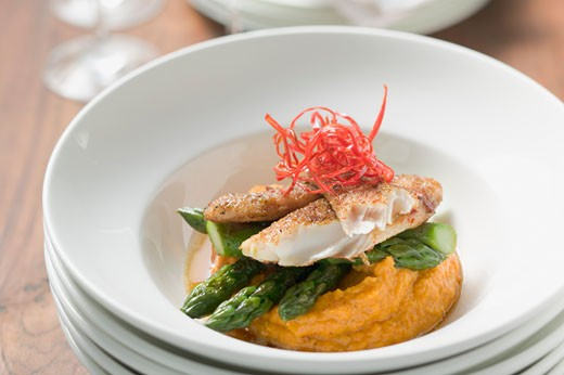 Pangasius fillet with asparagus and sweet potato puree : Stock Photo
