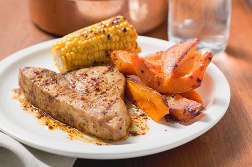 Tofu escalope with pumpkin and corn on the cob : Stock Photo