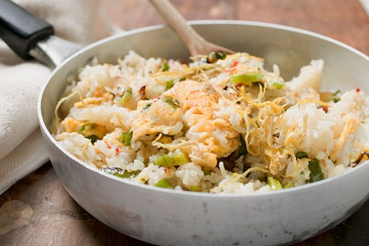 Pan-cooked rice and fish dish with lemon zest : Stock Photo